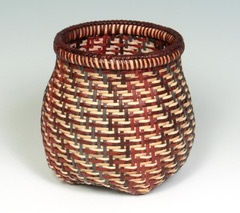 Interwoven Basket woven with natural and dyed cane for weavers and rim